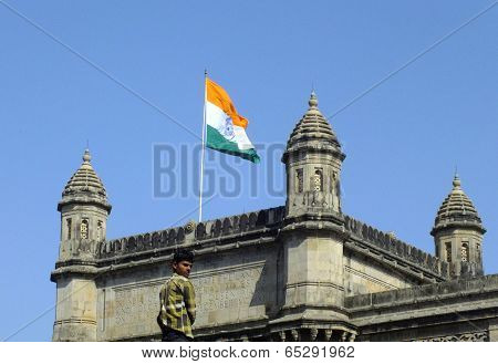 Indian boy standing in front of Gateway of India