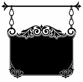 Wrought iron ornate vintage sign bracket in black and white with intricate scrollwork hanging from chain links from a rod for the front of an old town shop available in several different formats in gallery poster