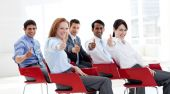 Business people with thumbs up at a conference. Business concept. poster