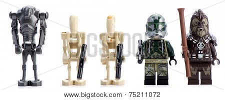 Ankara, Turkey - April 28, 2014: Lego Star Wars AT-AP minifigures Clone Commander Gree, Chief Tarfful  Battle Droid, Battle Droid Commander and Super Battle Droid isolated on white background.