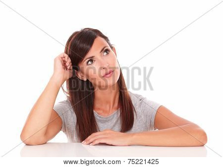 Portrait of interested lovely woman asking a question while looking to her left up on isolated white background - copyspace poster
