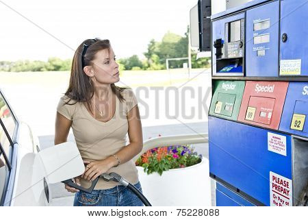Attractive Lady Pumping Gasoline