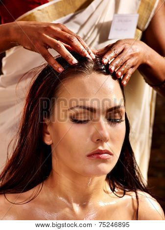 Young woman having head ayurveda spa treatment.