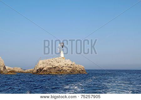 Small Light Off The East Coast Of Capri, Italy