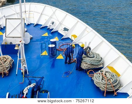 Deck Sailors Are Working With Ropes