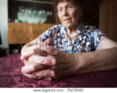 Old woman. Elderly female at home