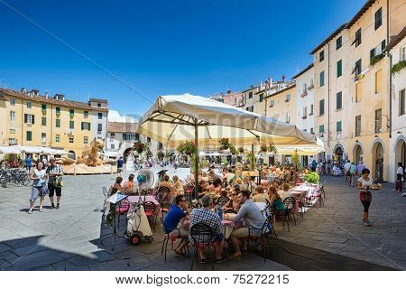 LUCCA, Italy 30 June 2014 people sitting outside at the restaurant on of Piazza Dell Anfiteatro, 30 June 2014 Lucca, Tuscany, Italy, Editorial for only