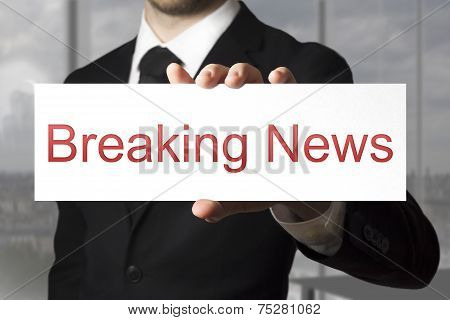 Businessman Holding Sign Breaking News