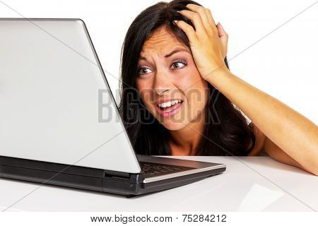 a young woman has trouble with her laptop computer. symbol photo for data crash, spam and computer viruses