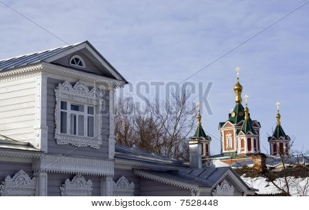 Wooden House And Church