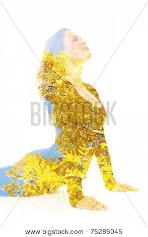 Double exposure portrait of young woman performing yoga asana