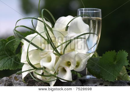 White bride Bouquet with a champagne glass