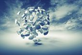 Abstract 3d object cloud of small spherical fragments on blue dramatic sky background poster