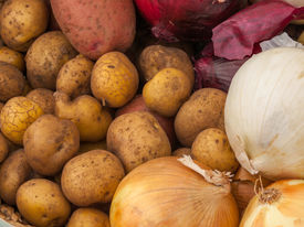 Fresh Potatoes And Onions At A Farmers Market