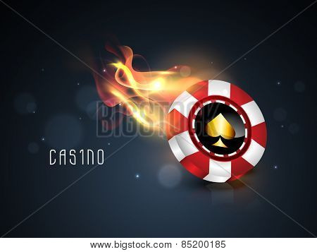 Glossy casino chip in flame on shiny blue background.
