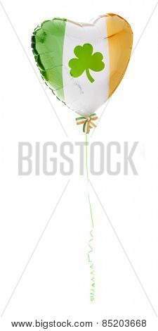 A floating green, white and orange heart-shaped balloon trailed by a curly green ribbon.  A shamrock adorns the middle and the end is tied with a tri-colored bow.  On a white background.