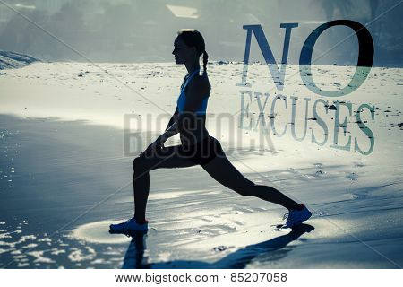 Fit woman doing lunges on the beach against no excuses