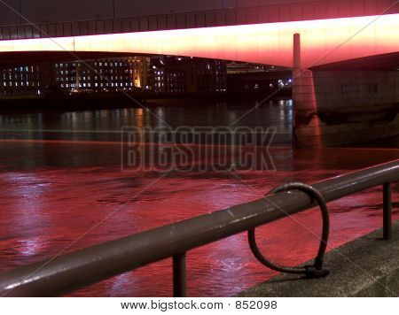 London Bridge by Night illuminated with the red lighting