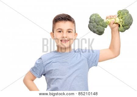Little boy exercising with a broccoli dumbbell isolated on white background