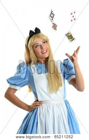 Beautiful young woman dressed in costume throwing playing cards into the air isolated over white background