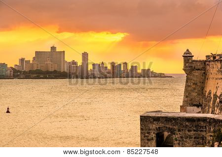 Beautiful sunset in Havana with El Morro castle on the foreground