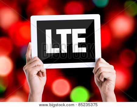 Tablet pc with text LTE with bokeh background
