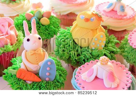 Easter bunny cupcakes with Easter eggs and a chick made of fondant.