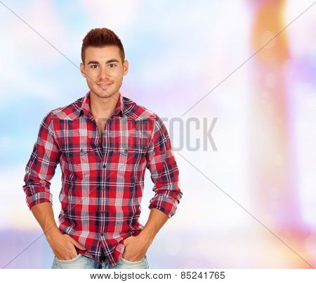 Casual handsome men with red plaid shirt on a unfocused background