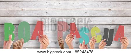 Hands holding up boa pasqua against digitally generated grey wooden planks