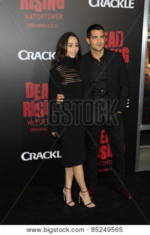 LOS ANGELES - MAR 11:  Cara Santana, Jesse Metcalfe at the