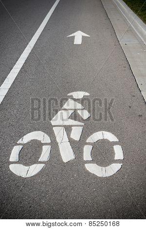A bike lane or bikeway symbol on asphalt roadway