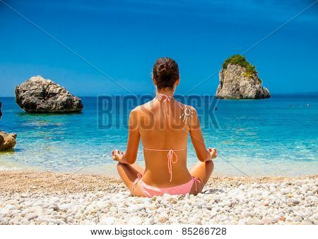 Beautiful relaxed young  woman has a meditation. Greece.