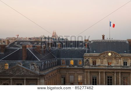 Paris roofs skyline at sundown