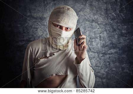 Injured Man With Head Bandages Using Mobile Phone