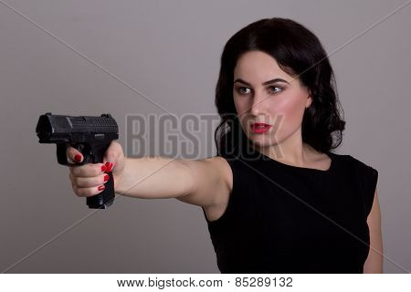 Serious Woman Shooting With Gun Isolated On White