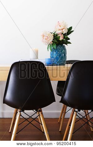 Contemporary Dining Table And Retro Chairs