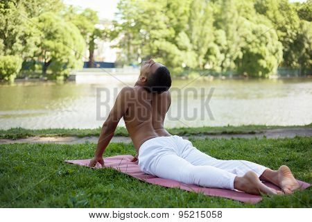 Yoga Pose Bhudjangasana On Nature