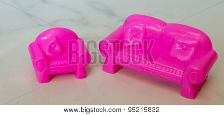 Furniture for dolls - pink plastic sofa and armchair