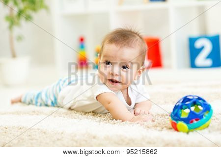 Crawling Funny Baby Boy On Floor At Home