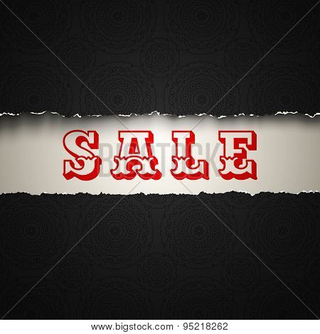 sale on torn paper