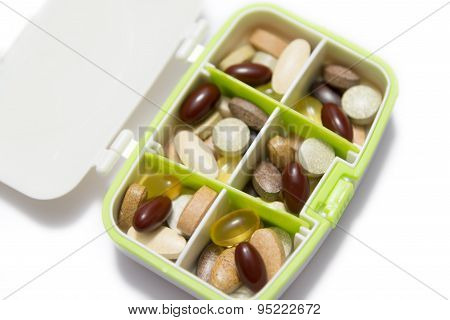 Many food supplement pills in box Isolated