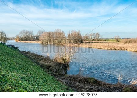 Banks Of A Small River In Wintertime