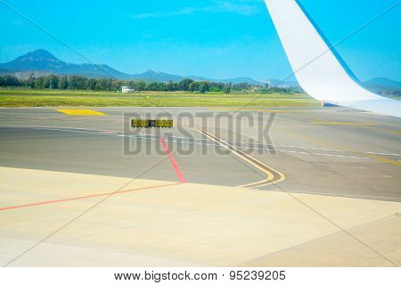Taxiway Signs And Airplane Wing