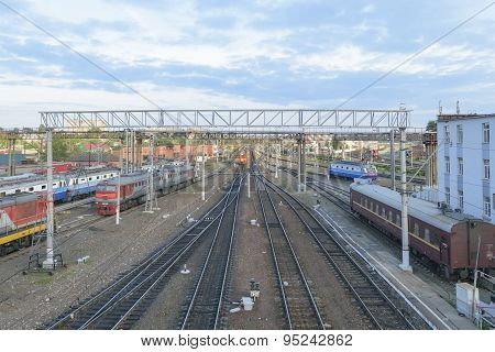 Major Train Station. Rails Stretching Into The Distance. Flaw Detector Car Is On The Tracks Near The
