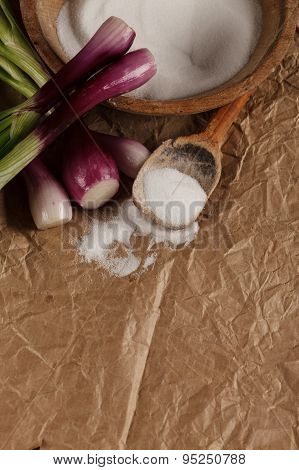 Salt With Onions On Crumpled Paper