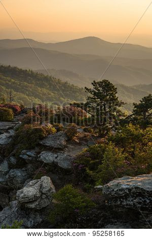 A Colorful sunrise over the Chimneys at the Linville Gorge Wilderness Area on a warm spring morning poster