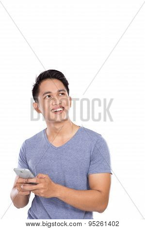 Man Holding A Handphone And Looking Up To Copyspace