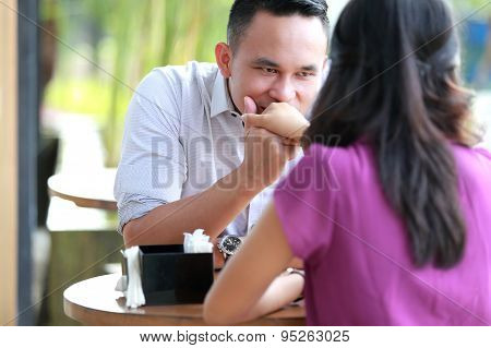 Handsome Man Kissing His Girlfriend Hand