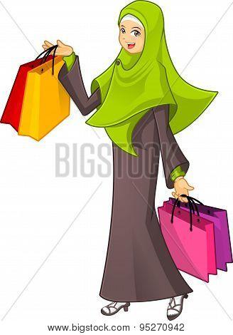 Muslim Woman Holding a Shopping Bag Wearing Green Veil