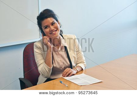 Business woman call to inquire more details about document